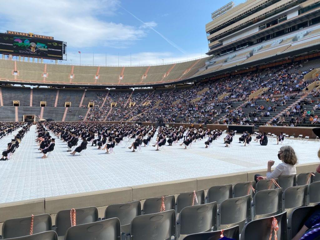 Graduates sitting in chairs on Neyland Stadium